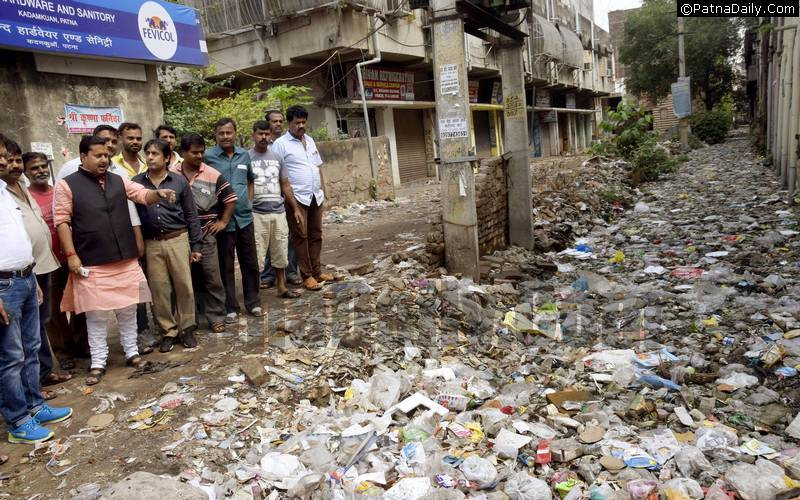 BJP MLA Nitin Navin is looking at a garbage pile in Pirmuhani area in Patna.