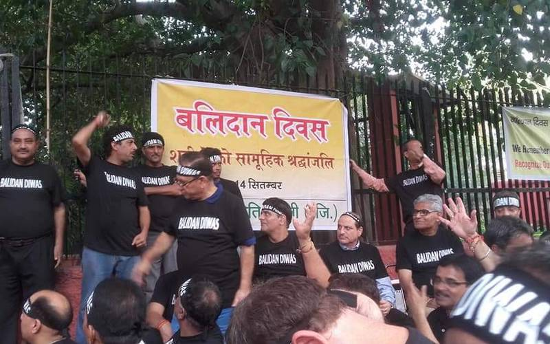 Kashmiri Pandits observing 'Balidan Diwas' in New Delhi on Friday.