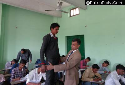 BSEB Secretary Anand Kishore conducting a body search for cheats during matric exam in Patna.