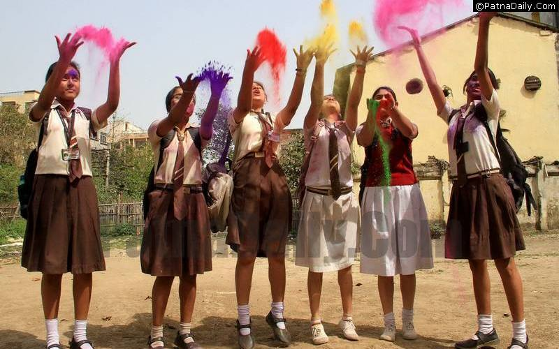 School children playing with 'gulal' on the occasion of Holi at a Patna school.