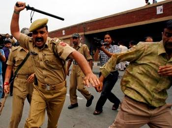 Indian police quelling a riot.