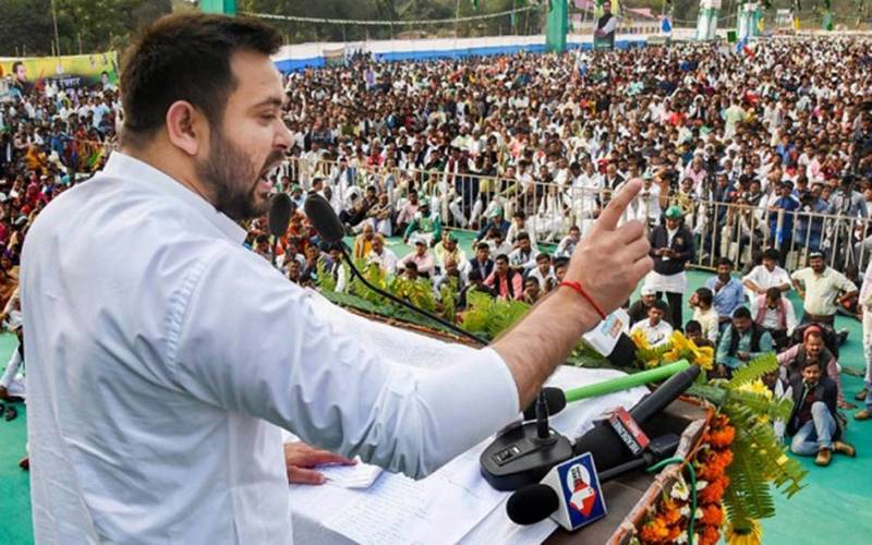 RJD leader Tejaswi Yadav speaking at a rally in Patna.