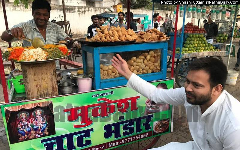 Tejaswi Yadav having some chaat at the gate of Patna Zoo on Wednesday.