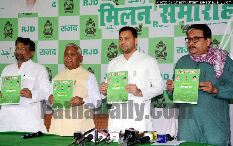 RJD leaders releasing election manifesto in Patna on Monday.