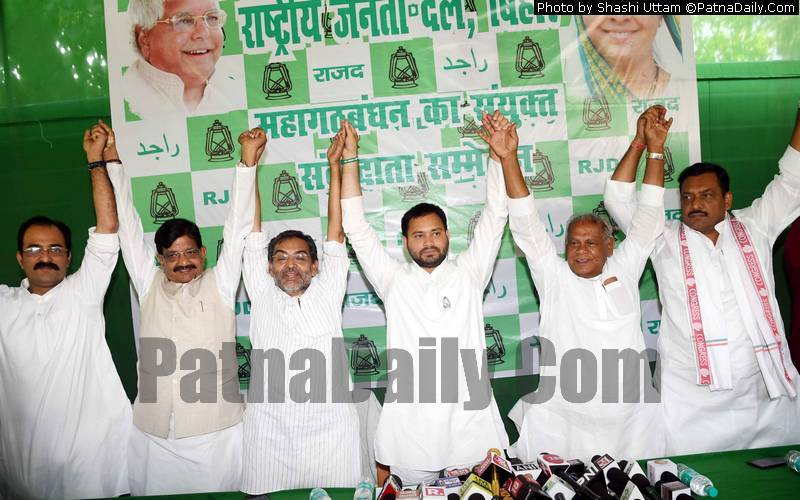 Grand Alliance leaders at a joint press conference in Patna on Monday.