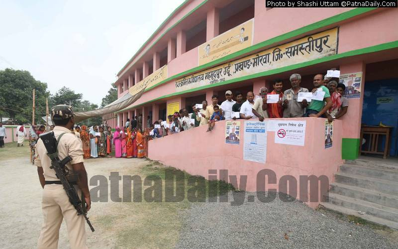 Voters line up at a polling booth in Samastipur district on Monday.