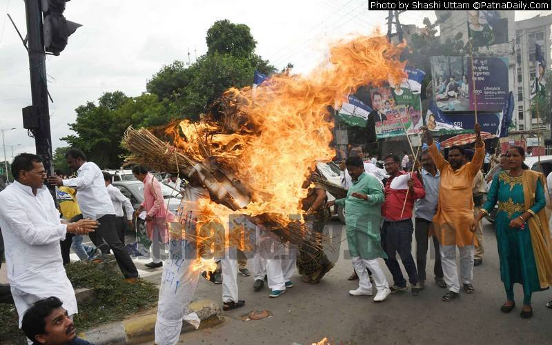 RLSP leaders burning effigy of Nitish Kumar in Patna on Tuesday.