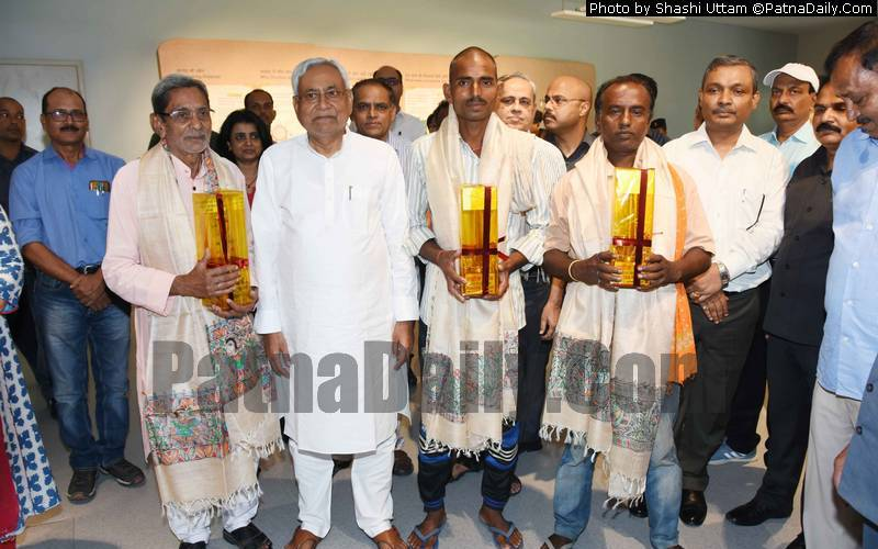 Nitish Kumar honoring farmers at Bihar Museum in Patna on Wednesday.