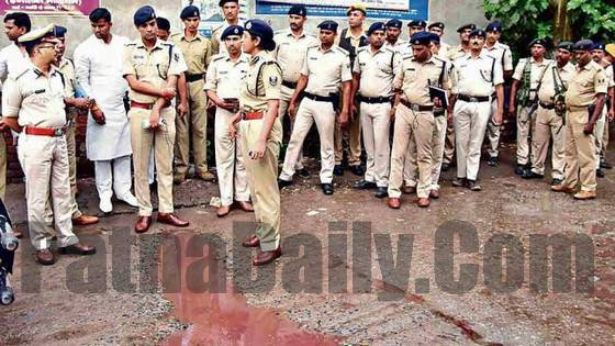 Police officials gather at the crime scene in Danapur on Wednesday.
