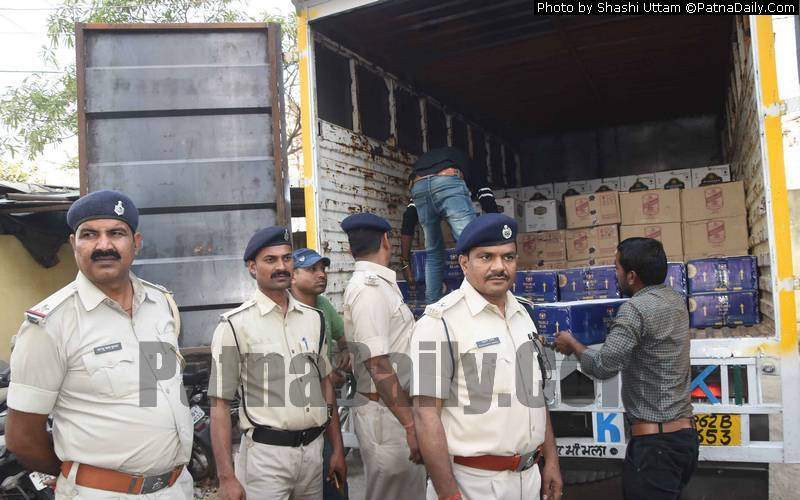Police seize a truck with bootlegged alcohol in Patna on Tuesday.