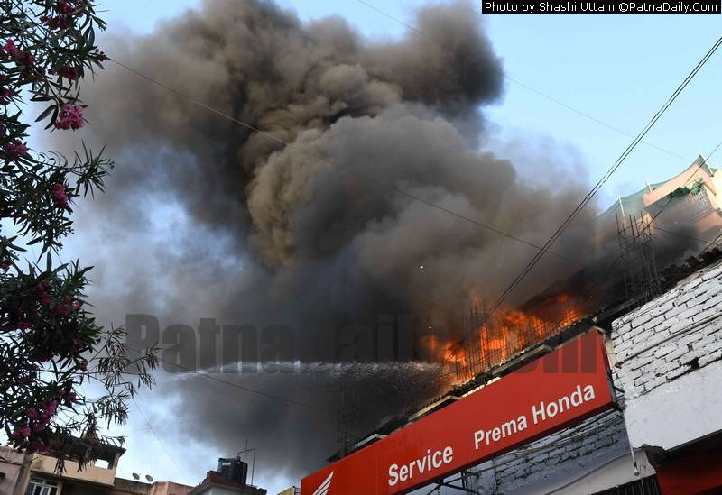 Fire breaks out at a Honda servicing center on Exhibition Road in Patna on Saturday.
