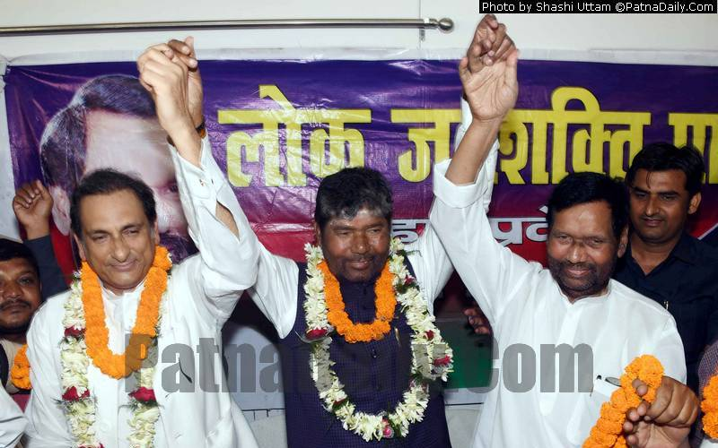 Chowdhary Mehboob Kaiser (left) with Pashupati Kumar Paras and Ram Vilas Paswan on Tuesday.