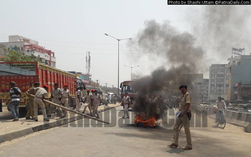 Protestors clash with police on Bypass Road in Patna on Tuesday.