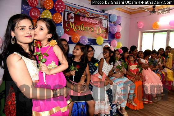 Teachers, parents, and children celebrate Mother's Day at Tender Heart School in Patna.