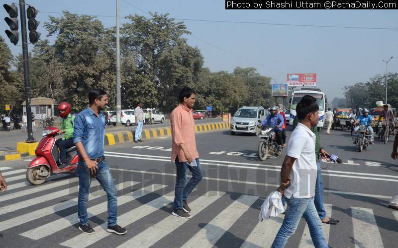 Pedestrians safely crossing the road at the new traffic signal system on Hartali Mor.