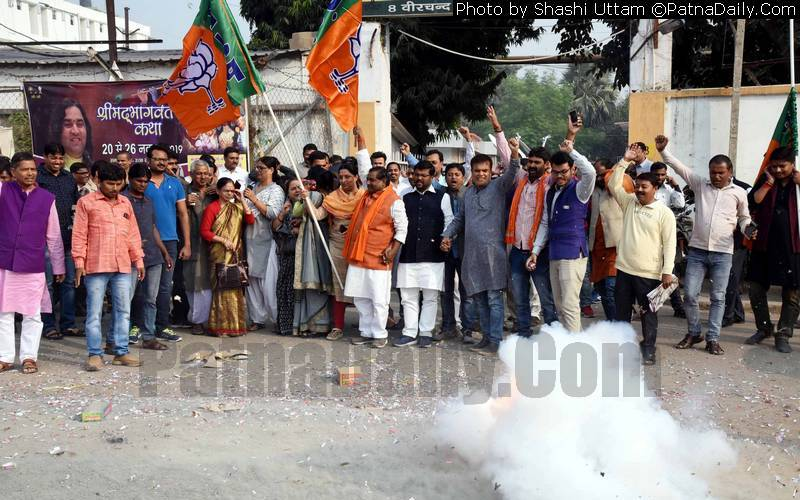 BJP leaders and workers celebrating outside party office in Patna on Saturday.