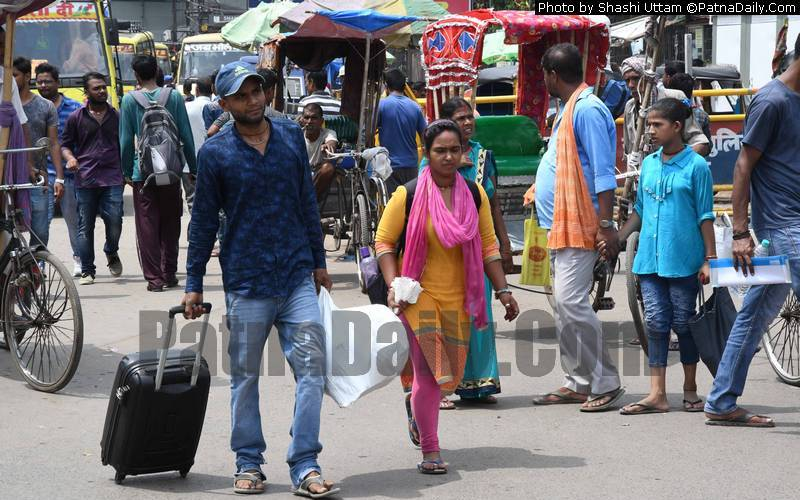 Passengers walking with their luggage outside Patna Junction on Tuesday.