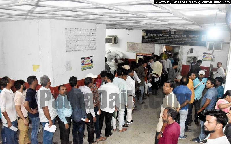 People waiting in line to get their learner's license in Patna on Wednesday.
