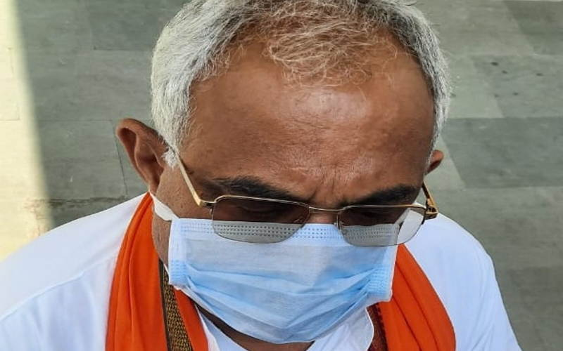 BJP legislator Sachchidanand Rai arrives at the state Assembly wearing a mask in view of the Corovirus threat.