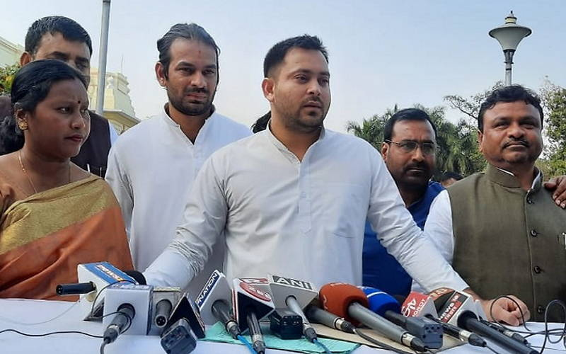 RJD leader Tejaswi Yadav speaking to reporters outside Bihar Assembly.