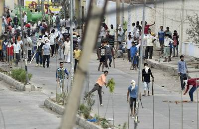 Dera chief's cult followers clash with police across north India.
