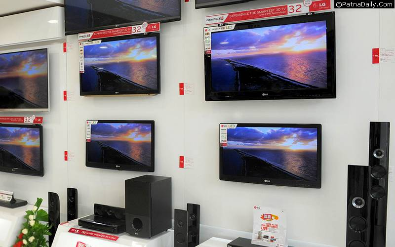 Flat-panel TV sets in an electronic shop.