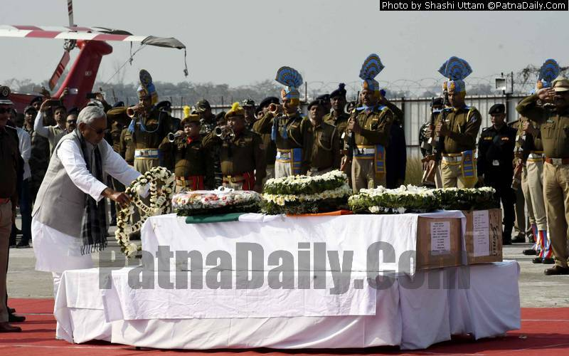 Chief Minister Nitish Kumar paying tribute to fallen jawans of Pulwama attack at Patna Airport on Saturday.