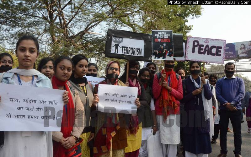 Patna students forming ahuman chain on Saturday to protest against terrorism in the world.