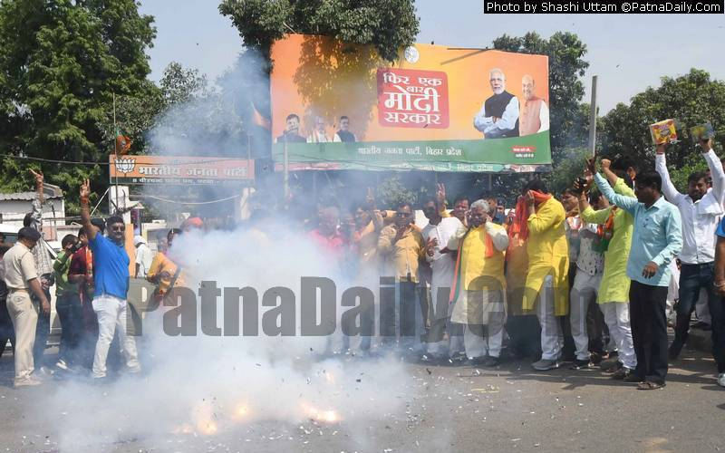 NDA supporters celebrate in Patna on Thursday.