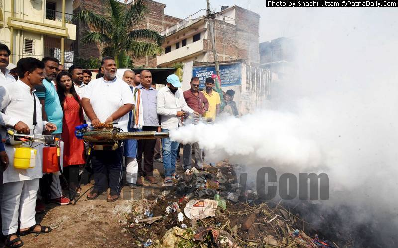 Pappu Yadav spraying chemical with a fogging machine to check mosquito growth in Patna.