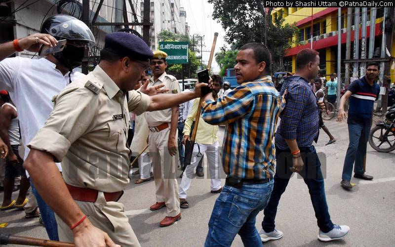 Land Reform Bank contractual workers clash with police in Patna on Wednesday.