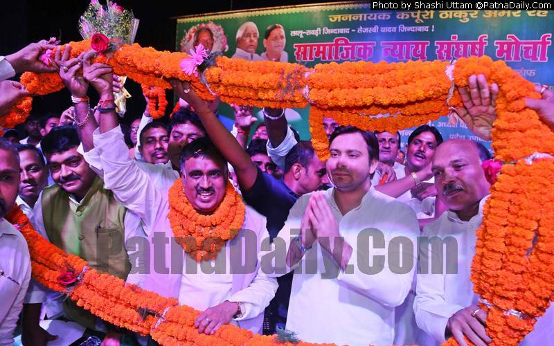 Tejaswi Yadav welcoming Azad Gandhi in the party on Thursday.