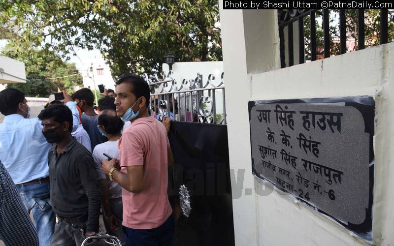 Crowd gathers outside the home of Bollywood star Sushant Singh Rajput in Patna on Sunday following his suicide in Mumbai.
